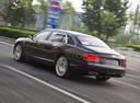 Фото авто Bentley Flying Spur 1 поколение, ракурс: 135 цвет: фиолетовый