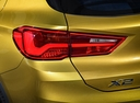 Фото авто BMW X2 F39, ракурс: задние фонари цвет: золотой