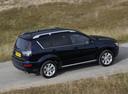 Фото авто Mitsubishi Outlander XL [рестайлинг], ракурс: 225 цвет: черный