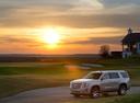 Фото авто Cadillac Escalade 4 поколение, ракурс: 45 цвет: серебряный