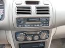 Фото авто Toyota Corolla E110, ракурс: центральная консоль
