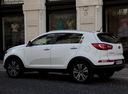 Фото авто Kia Sportage 3 поколение, ракурс: 135 цвет: белый