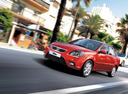Фото авто Kia Rio 2 поколение [рестайлинг], ракурс: 45 цвет: красный