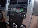 Фото авто Kia Cerato 1 поколение [рестайлинг], ракурс: центральная консоль