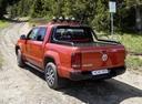 Фото авто Volkswagen Amarok 1 поколение, ракурс: 135 цвет: оранжевый