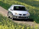 Фото авто Mitsubishi Lancer IX, ракурс: 315 цвет: серебряный