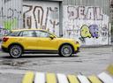 Фото авто Audi Q2 1 поколение, ракурс: 270 цвет: желтый