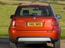 Фото авто Suzuki SX4 1 поколение [рестайлинг], ракурс: 180 цвет: оранжевый