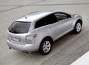 Фото авто Mazda CX-7 1 поколение, ракурс: 225 цвет: серебряный