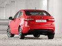 Фото авто Kia Rio 3 поколение, ракурс: 180 цвет: красный