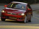 Фото авто Mitsubishi Lancer X,  цвет: красный