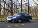 Фото авто Kia Spectra 1 поколение [рестайлинг], ракурс: 45 цвет: синий