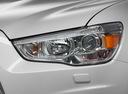 Фото авто Mitsubishi ASX 1 поколение [рестайлинг], ракурс: передние фары цвет: белый