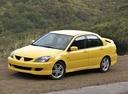 Фото авто Mitsubishi Lancer IX, ракурс: 45 цвет: желтый