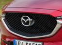 Фото авто Mazda CX-5 2 поколение, ракурс: передняя часть цвет: красный