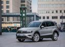 Фото авто Volkswagen Tiguan 2 поколение, ракурс: 45 цвет: серый
