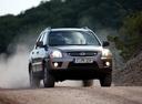 Фото авто Kia Sportage 2 поколение [рестайлинг], ракурс: 315 цвет: серебряный