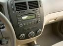 Фото авто Kia Spectra 2 поколение [рестайлинг], ракурс: центральная консоль