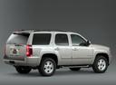 Фото авто Chevrolet Tahoe GMT900, ракурс: 270 цвет: серебряный