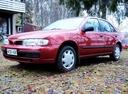 Фото авто Nissan Almera N15, ракурс: 45 цвет: красный