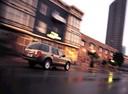 Фото авто Ford Explorer 3 поколение, ракурс: 225 цвет: коричневый