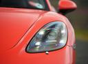 Фото авто Porsche Boxster 982, ракурс: передние фары цвет: оранжевый