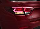 Фото авто Kia Rio 4 поколение, ракурс: задние фонари цвет: бордовый