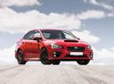 Фото авто Subaru Impreza 4 поколение, ракурс: 315 цвет: красный