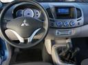 Фото авто Mitsubishi L200 4 поколение, ракурс: рулевое колесо
