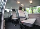 Фото авто Volkswagen Caravelle T6, ракурс: салон целиком цвет: черный