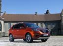 Фото авто Renault Koleos 1 поколение [рестайлинг], ракурс: 315 цвет: оранжевый