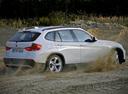Фото авто BMW X1 E84, ракурс: 225 цвет: белый