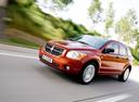 Фото авто Dodge Caliber 1 поколение, ракурс: 45 цвет: оранжевый