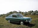 Фото авто Mazda Familia 2 поколение, ракурс: 315 цвет: зеленый