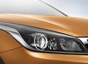 Фото авто Kia Rio 4 поколение, ракурс: передние фары цвет: оранжевый