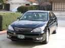 Фото авто Toyota Camry XV30 [рестайлинг], ракурс: 45 цвет: черный
