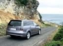 Фото авто Mitsubishi Grandis 1 поколение, ракурс: 225 цвет: фиолетовый