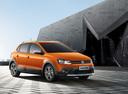 Фото авто Volkswagen Polo 5 поколение, ракурс: 315 цвет: оранжевый