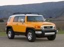 Фото авто Toyota FJ Cruiser 1 поколение, ракурс: 315 цвет: желтый