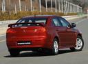 Фото авто Mitsubishi Lancer X, ракурс: 225 цвет: красный