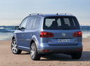 Фото авто Volkswagen Touran 1 поколение [2-й рестайлинг], ракурс: 225 цвет: синий