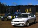 Фото авто Subaru Impreza 1 поколение [рестайлинг], ракурс: 45 цвет: белый