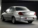 Фото авто Kia Spectra 1 поколение [рестайлинг], ракурс: 135 цвет: серебряный