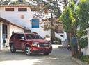 Фото авто Chevrolet Tahoe 4 поколение, ракурс: 315 цвет: красный