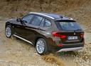 Фото авто BMW X1 E84, ракурс: 135 цвет: коричневый