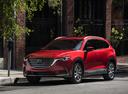Фото авто Mazda CX-9 2 поколение, ракурс: 45 цвет: красный