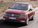 Фото авто Volkswagen Tiguan 2 поколение, ракурс: 45 цвет: красный