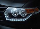 Фото авто УАЗ Patriot 2 поколение, ракурс: передние фары цвет: черный