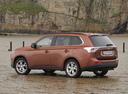 Фото авто Mitsubishi Outlander 3 поколение, ракурс: 135 цвет: оранжевый