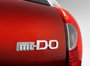 Фото авто Datsun mi-Do 1 поколение, ракурс: шильдик цвет: оранжевый